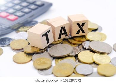 Tax conceptual image over coin