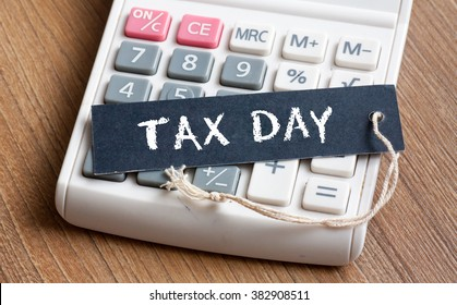 Tax Day words written on label with calculator,Business Concept