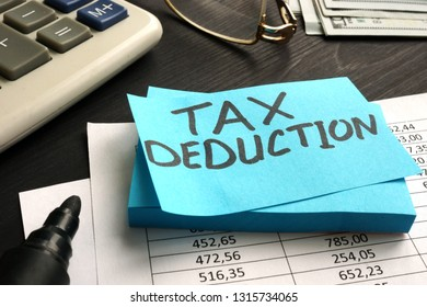 Tax deduction written on a piece of paper.