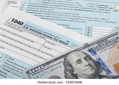 Tax Form 1040 with 100 dollars banknote