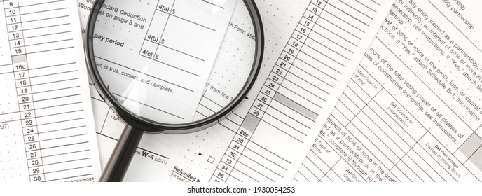 Tax Form 1040 with magnifying glass. Tax concept