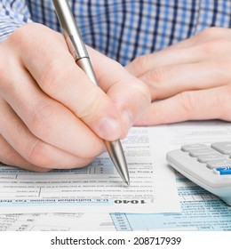 Tax Form 1040 - male filling out tax form - 1 to 1 ratio