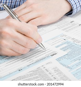 Tax Form 1040 - man performing tax calculations - 1 to 1 ratio
