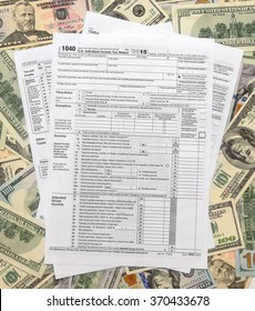 Tax form 1040 on US dollars background