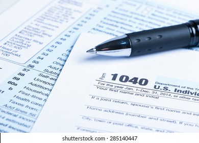 Tax form business financial concept with a pen aside.