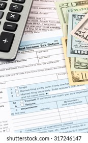 Tax form with calculator and banknote taxation concept