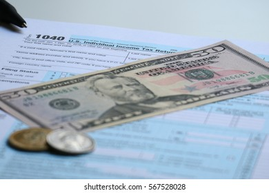 Tax form with dollar cash and pen, tax season and accounting finance concept