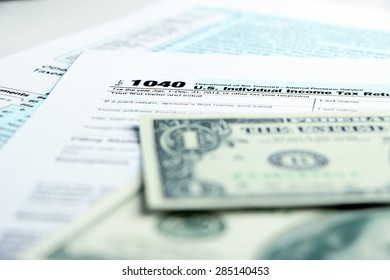 Tax form financial concept with money and some other business objects aside.