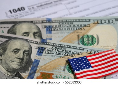 Tax form with Flag of the United States, coin and banknote, tax season and finance concept