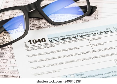 Tax form with glasses  taxation concept