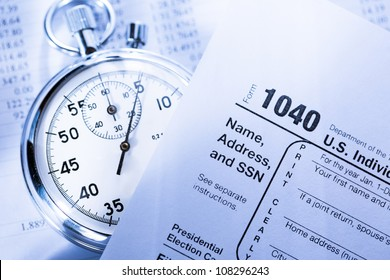Tax form, operating budget and stopwatch