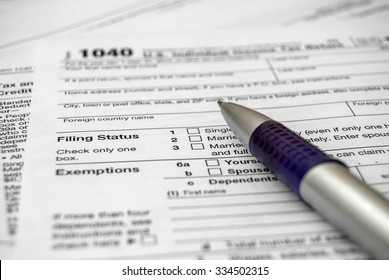 Tax form with pen