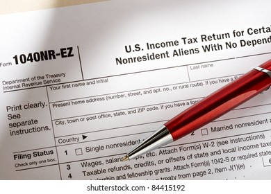 Tax form and pen