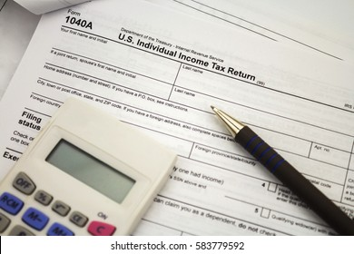 tax form with pen and calculator