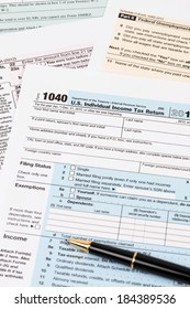 Tax form with pen taxation concept