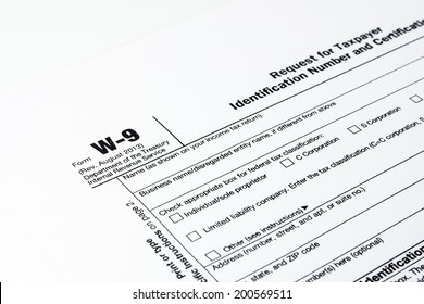 Tax form W-9 and pen