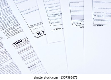 Tax Forms 1040, w-2, w-2c, w-2g, 1099r on background other forms