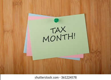 Tax Month! written on green paper note