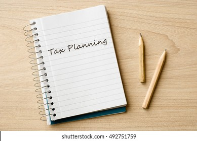 tax planning on notebook on desk