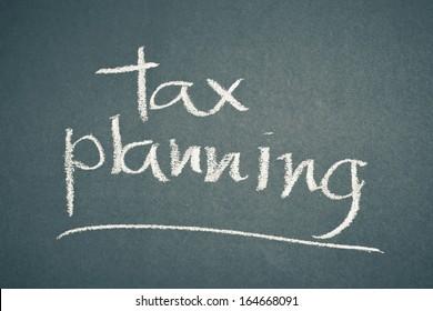 Tax planning word written by chalk