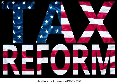 tax reform bold letters sign on american flag with black background