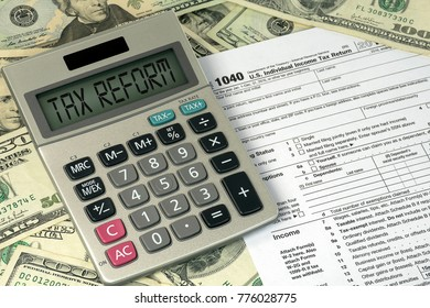 tax reform text on calculator with 1040 income tax form and American paper money