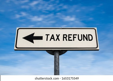Tax refund road sign, arrow on blue sky background. One way blank road sign with copy space. Arrow on a pole pointing in one direction.