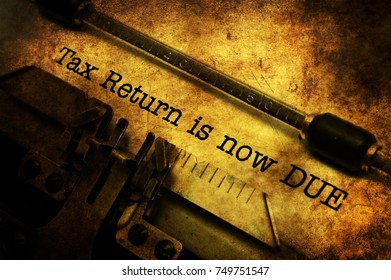 Tax return is now due grunge concept