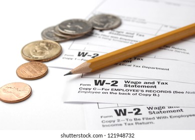 Tax return papers, pen?il and money on the white background