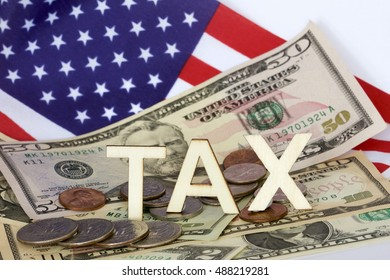 Tax sign with background of American money and flag.