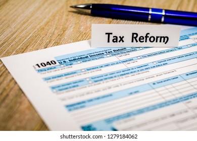Tax still life business finance concept, form 1040, with calculator, pen shallow DOF