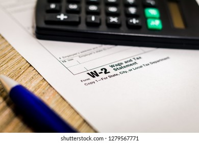 Tax still life business finance concept with tax form W2 and pen, shallow DOF