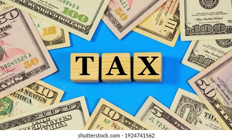 Tax. Text inscription on the background of banknotes. Mandatory gratuitous payment for the purpose of financial support of the state's activities.