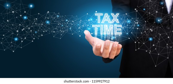 Tax time concept. Tax time in the hand of business.