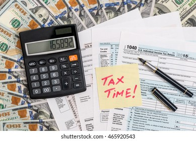 tax time. tax form with money. pen