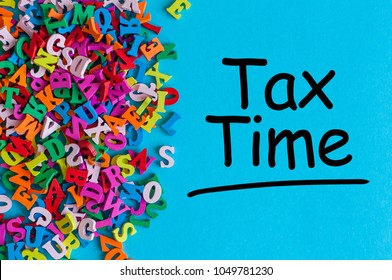 Tax time - message on an office desk with many little letters