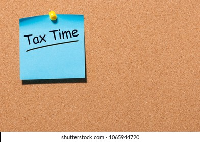 Tax time - Notification of the need to file tax returns pinned at cork board, tax form at accauntant workplace. With empty space for text, mockup or template
