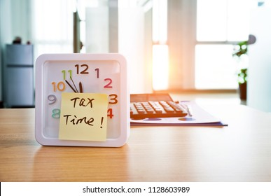 Tax time on the alarm clock face in office