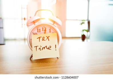 Tax time on the alarm clock face