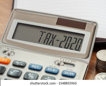 Tax word and 2020 number on calculator. Business and tax concept. Pay tax in 2020 years.