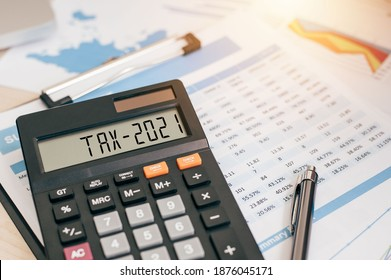 Tax word and 2021 number on a calculator. Business and tax concept. Pay tax in 2021 years. The new year 2021 tax concept