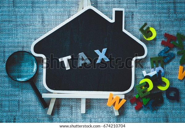 TAX words on wooden  background