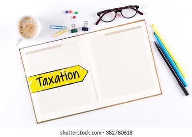 Taxation text on notebook with copy space