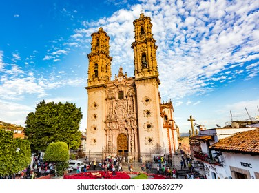TAXCO, MEXICO - DECEMBER 27, 2015: The Cathedral. Taxco is heavily associated with silver, both with the mining of it and other metals and for the crafting of it into jewelry silverware.