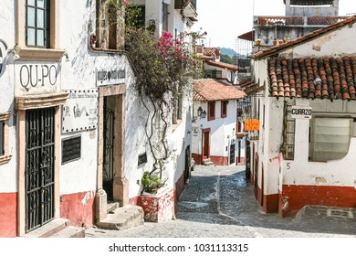 TAXCO, MEXICO - march 3, 2012: One of central streets with typical architecture of Taxco, Mexico