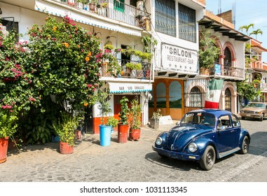 TAXCO, MEXICO - march 3, 2012: View of one of the central streets with typical VW Beetle car in Taxco, Mexico