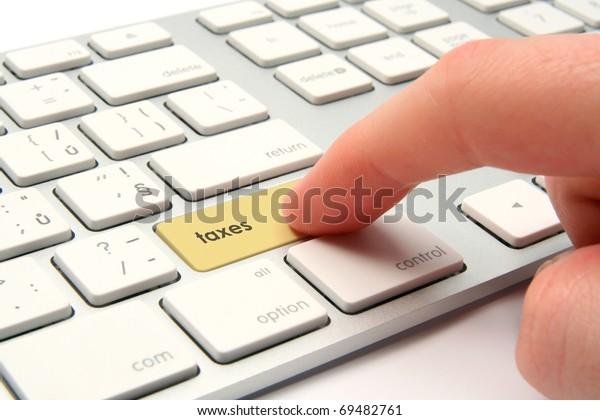 Taxes concept - keyboard with taxes button