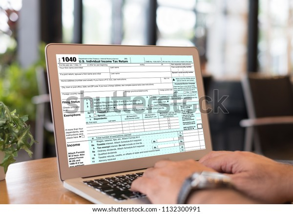 Taxes Payment Concept Accountant Filling Individual Stock
