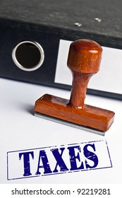 Taxes stamp on white paper