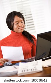 Taxes: Woman Using Computer To Work Out Taxes